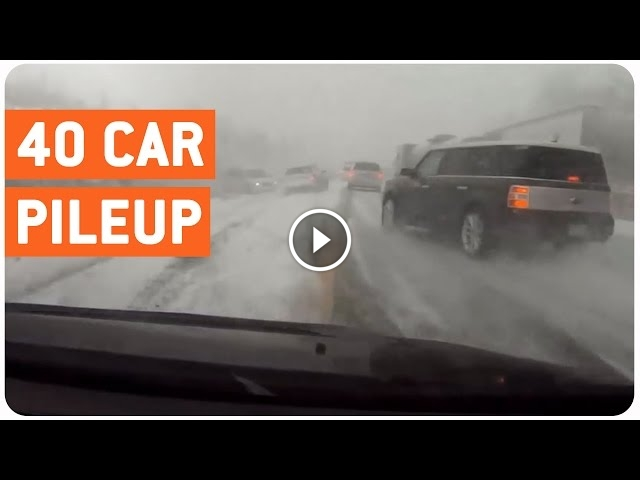 Driver Narrowly Misses Car Pile Up In Winter Storm